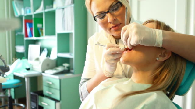 dentist at work. - dental equipment stock videos and b-roll footage
