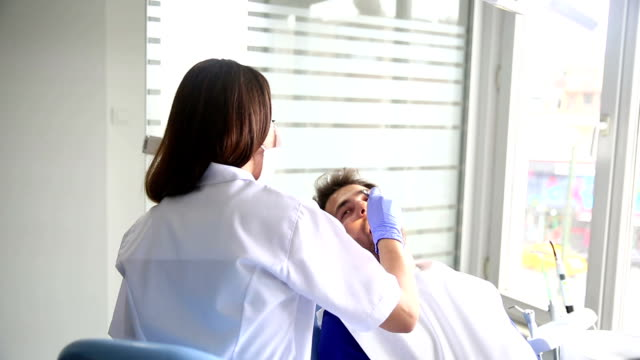 dentist at work - medical procedure stock videos and b-roll footage