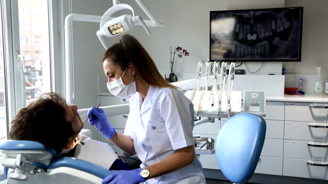 dentist at work - dental hygiene stock videos & royalty-free footage