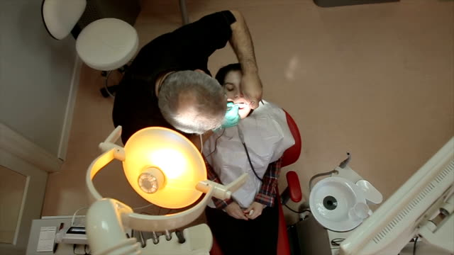 dentist curing a female patient - filling stock videos & royalty-free footage