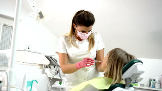 Dentist gives an anesthesia to the patient