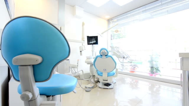 dolly shot: dentist office - praxis stock-videos und b-roll-filmmaterial