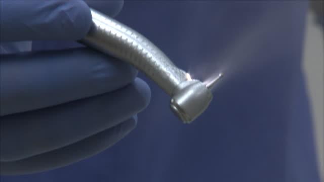 dentist operating a dental drill - drill stock videos & royalty-free footage