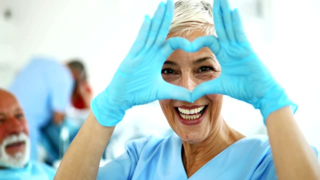 dentist showing heart symbol. - form of communication stock videos & royalty-free footage