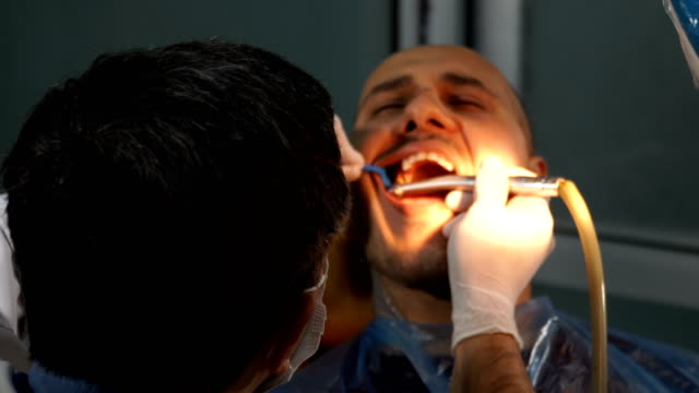 dentist treating a patient - dental implants stock videos and b-roll footage
