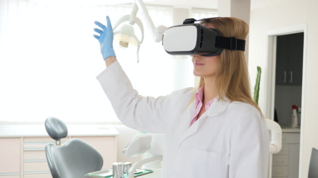 dentist with virtual reality headset - dental equipment stock videos and b-roll footage