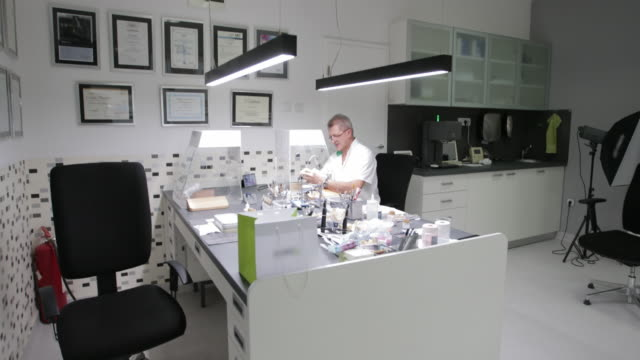 dentist working on tooth crown using protective chamber - tooth cap stock videos and b-roll footage