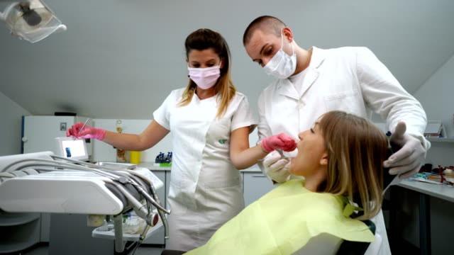 Dentists explaining X-Ray image to patient