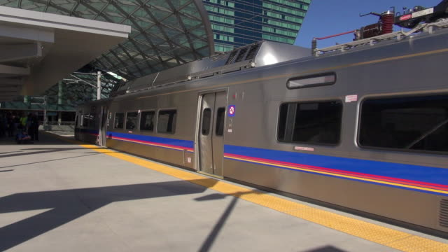 denver airport train arriving at station - train vehicle stock videos and b-roll footage