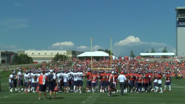 denver broncos fans routinely pack the practice facility for training camp practices getting autographs and cheering on the team during the early... - autographing stock videos & royalty-free footage
