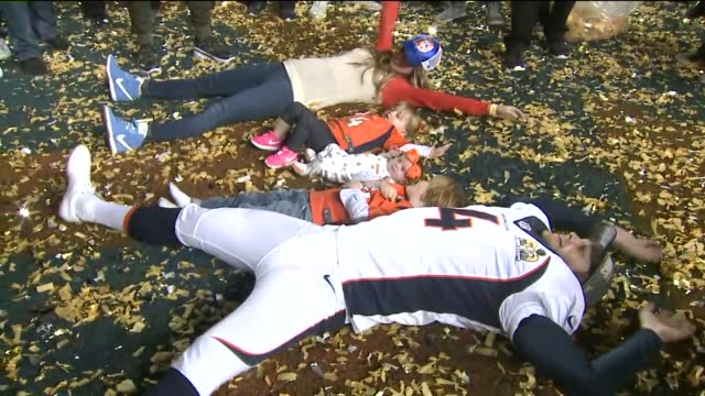 kdvr denver broncos player britton colquitt with family makes snow angels in confetti after his team won the super bowl in santa clara california on... - super bowl stock videos & royalty-free footage