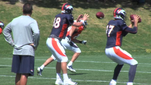 Denver Broncos practice Peyton Manning throwing to receivers and running backs including Montee Ball Ronnie Hillman and Eric Decker on August 20 2013...