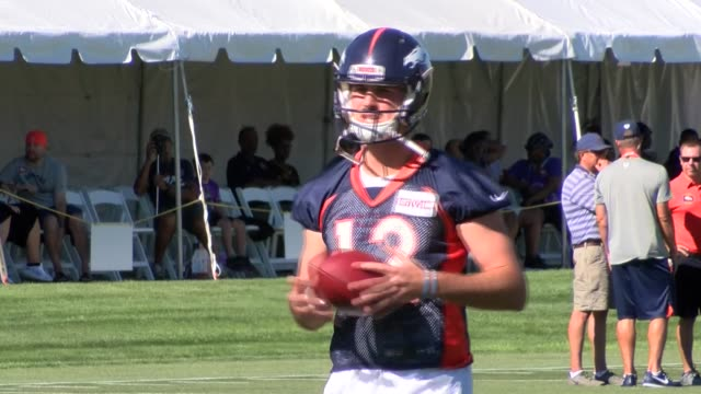 Denver Broncos quarterback Paxton Lynch practicing during training camp at the team's practice facility UC Health Training Center