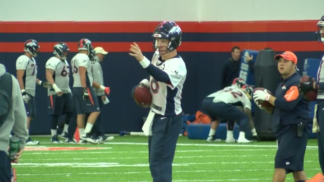 Denver Broncos quarterback Peyton Manning practicing after missing four games with foot injury Manning and quarterback Brock Osweiler practice at the...