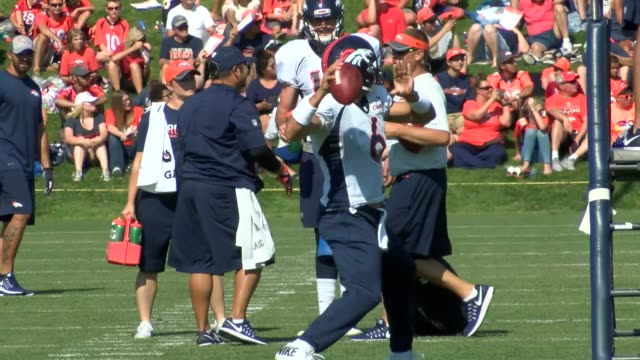 Denver Broncos quarterbacks Mark Sanchez Trevor Siemian and Paxton Lynch practicing during training camp at the UC Health Center facility