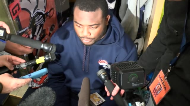 denver broncos running back c.j. anderson give an interview to the ress in the locker room about peyton manning being named the starting quarterback... - playoffs stock videos & royalty-free footage