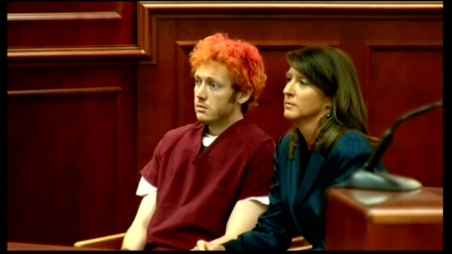james holmes appears in court usa colorado centennial int james holmes accused of shooting dead 12 people during a gun attack on a cinema in aurora... - prison jumpsuit stock videos & royalty-free footage
