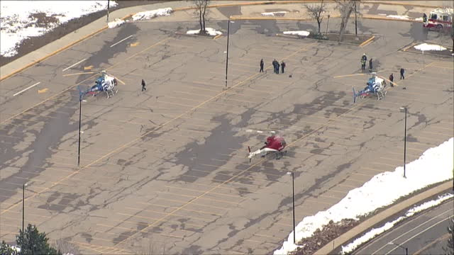 denver, co, u.s. - aerial view of air ambulances on scene of mass shooting at boulder grocery store king soopers on monday, march 22 where ten... - boulder stock videos & royalty-free footage