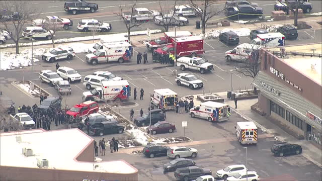 denver, co, u.s. - aerial view of mass shooting scene at boulder grocery store king soopers on monday, march 22 where ten people, including a boulder... - boulder stock videos & royalty-free footage