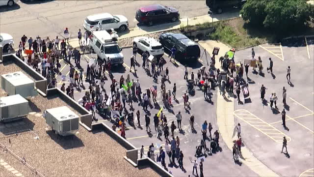 denver, co, u.s. - aerial view of people gathering on paring lot to protest school mask mandate on wednesday, august 4, 2021. most colorado counties... - peel stock videos & royalty-free footage