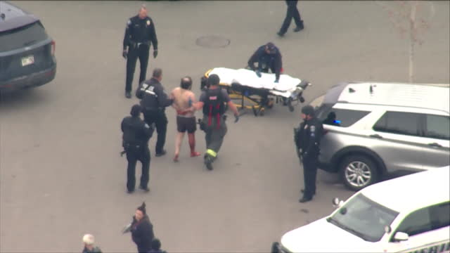 denver, co, u.s. - aerial view of police force arresting wounded man on scene of mass shooting at boulder king soopers on monday, march 22 where ten... - boulder stock videos & royalty-free footage