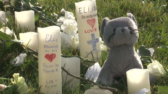 denver, co, u.s. - candles and flowers on utah park lawn honoring elijah mcclain on saturday, july 11, 2020. we shall overcome, now, and other vigil... - 追悼行事点の映像素材/bロール
