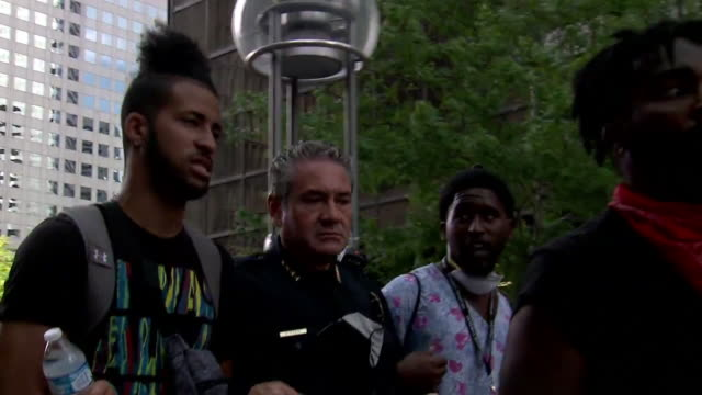 denver, co, u.s. - denver police chief paul pazen walks arm-in-arm with protestors at george floyd protest at civic center park on monday, june 1,... - embracing stock videos & royalty-free footage