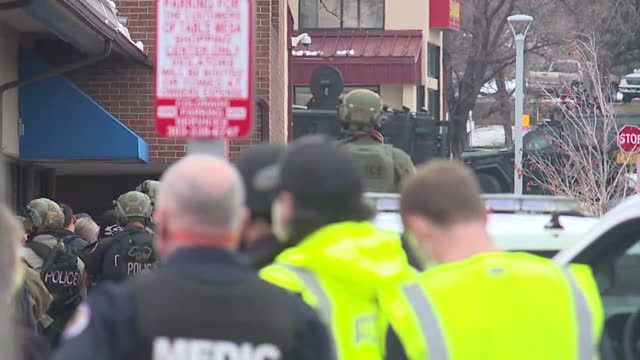 denver, co, u.s. - first responders on scene of mass shooting at boulder grocery store king soopers on monday, march 22 where ten people, including a... - boulder stock videos & royalty-free footage