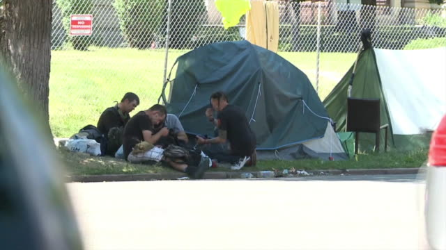 denver, co, u.s. - homeless camp encroaches on denver middle school. residents in the capitol hill neighborhood say a homeless camp is spreading and... - homelessness stock videos & royalty-free footage