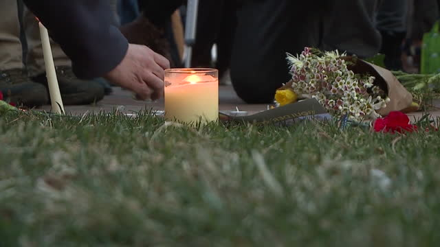 denver, co, u.s. - memorabilia, flowers and candles brought by participants of vigil to honor victims of mass shooting. hundreds of people gathered... - boulder stock videos & royalty-free footage