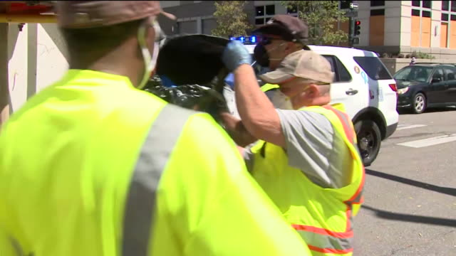 denver, co, u.s. - police force overlooking homeless camp clean up. colorado state patrol, along with the denver police homeless unit, are working to... - kopfbedeckung stock-videos und b-roll-filmmaterial