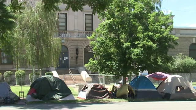 denver, co, u.s. - various shots of homeless camp spreading. residents in the capitol hill neighborhood say a homeless camp is spreading and... - homelessness stock videos & royalty-free footage