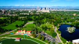 Denver Colorado at City Park high above Mile High City with Rocky Mountain Background