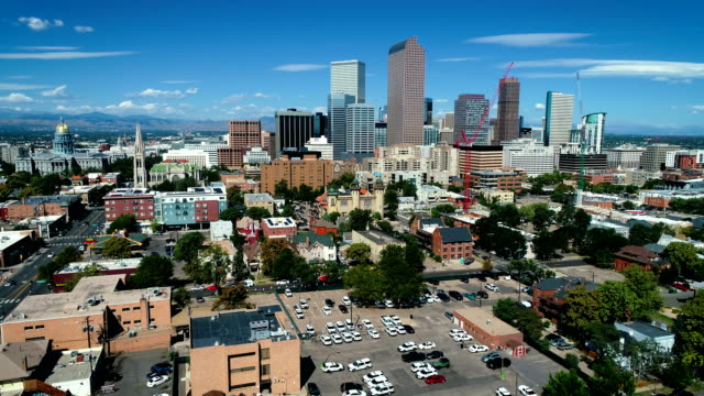 denver colorado forward low moving towards cityscape of the mile high city skyscrapers and capitol building - denver stock videos & royalty-free footage