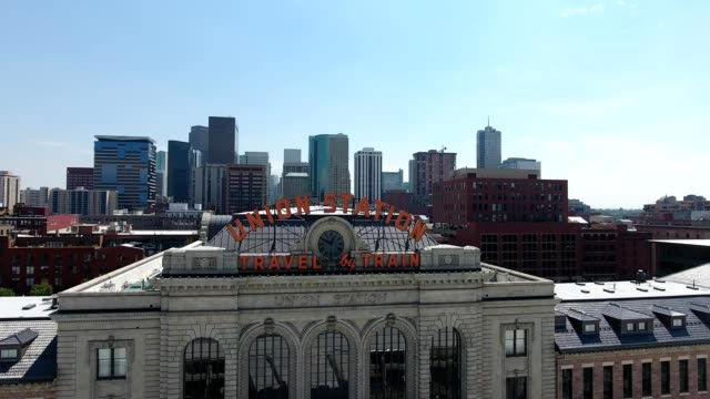 denver, colorado's union station with cityscape in the background - denver stock videos and b-roll footage