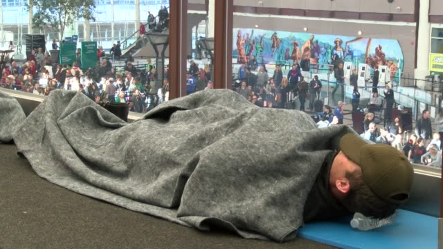 Denver International Airport passengers were stranded overnight by a powerful spring blizzard that resulted in so many cancelled flights hundreds of...