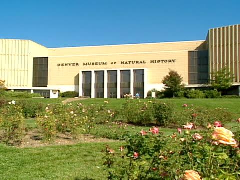 Denver Museum of Natural History w/ rose garden in FG building long single story ZI entrance