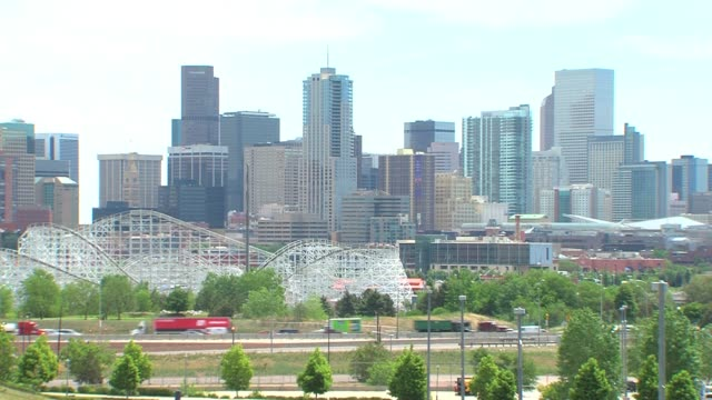 denver skyline in summer shots of prominent buildings and the six flags amusement park that make up the denver skyline denver city skyline on july 12... - herbst stock videos & royalty-free footage