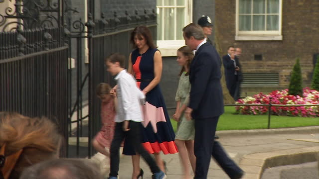 departing prime minister david cameron and family waving posing for photographs and hugging as they leave 10 downing street for the final time - david cameron politician stock videos & royalty-free footage