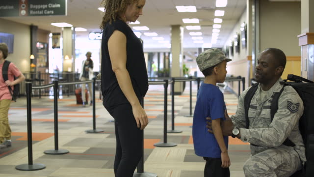 departing soldier saying goodbye to his family at an airport - saying goodbye stock videos & royalty-free footage