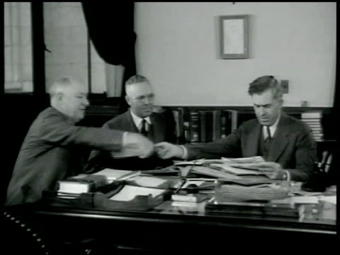 vidéos et rushes de department of agriculture building henry a wallace [r] in office going through papers aaa poster men in aaa office farmer filling out papers outside... - 1936
