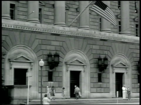 stockvideo's en b-roll-footage met department of commerce building int office w/ nelson rockefeller holding papers talking w/ secretary - 1942