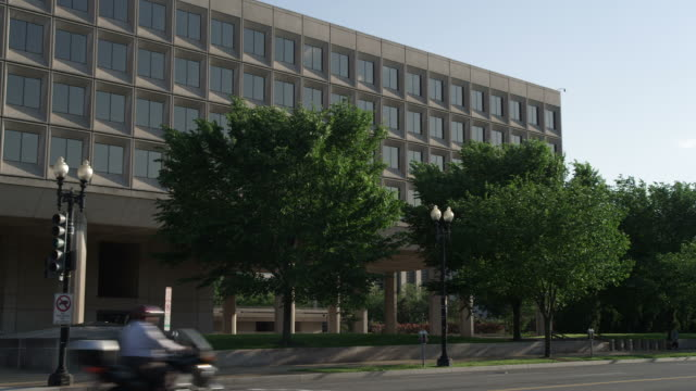 US Department of Energy building in L'Enfant Plaza, Washington DC; traffic in foreground. Shot in May 2012.