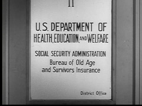 1954 b/w cu zi us department of health, education, and welfare sign on door / usa - social security stock videos & royalty-free footage
