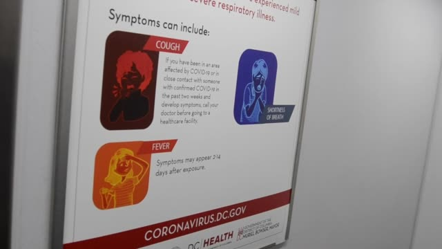 department of health sign describes the symptoms of covid19 on the dc metro amid the coronavirus pandemic in washington dc - symptom stock videos & royalty-free footage