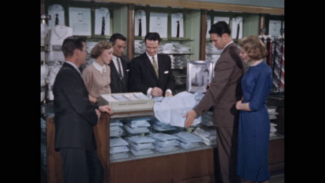 department store salesman promotes men's shirt to group of shoppers - sales occupation stock videos & royalty-free footage