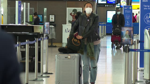departure hall at heathrow airport, as travel opens back up from england as coronavirus lockdown restrictions ease - leaf stock videos & royalty-free footage