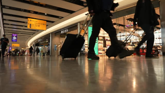 departure hall at heathrow airport with tourists travelling to portugal, as travel from the uk to green list countries, is allowed again during the... - leaf stock videos & royalty-free footage