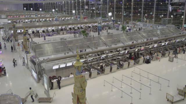 departure level of suvarnabhumi international airport - airport departure area stock videos & royalty-free footage