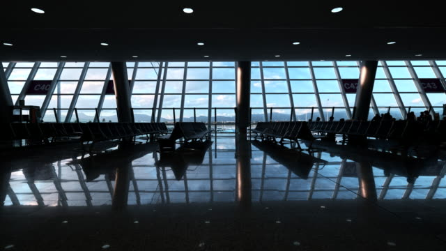 departure lounge majorca airport standing camera moving clouds and people - majorca stock videos & royalty-free footage